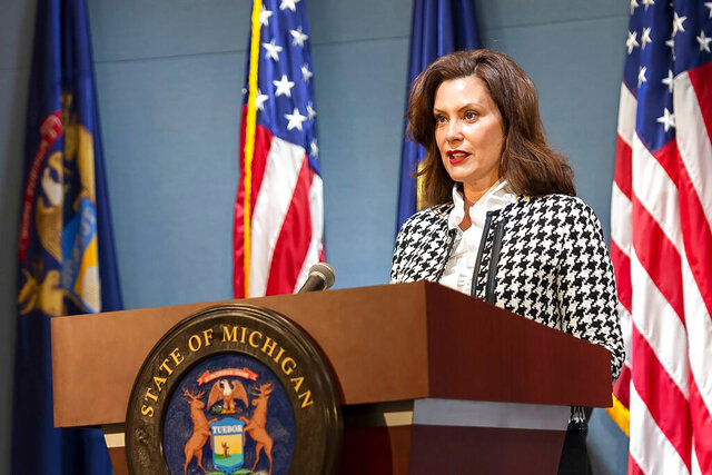 In this photo provided by the Michigan Executive Office of the Governor, Gov. Gretchen Whitmer speaks during a news conference Tuesday, May 26, 2020, in Lansing, Mich. Whitmer announced that people who leave their home for work or those who have coronavirus symptoms can be tested without needing a doctor's note. It was the state's latest move to expand COVID-19 testing, which is seen as a critical to slowing the virus particularly as the governor loosens stay-at-home restrictions. (Michigan Executive Office of the Governor via AP)