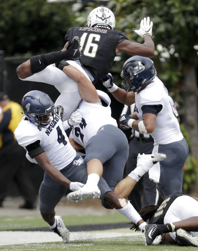 Vanderbilt wide receiver Kalija Lipscomb (16) is stopped by Nevada defenders EJ Muhammad (4) and Lucas Weber (24) in the first half of an NCAA college football game Saturday, Sept. 8, 2018, in Nashville, Tenn. (AP Photo/Mark Humphrey)