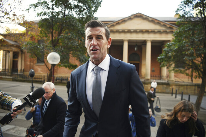 Ben Roberts-Smith arrives at the Federal Court in Sydney, Monday, June 7, 2021. Roberts-Smith, Australia's most decorated living veteran, began a defamation trial against three Australian newspapers that he alleges depicted him as a criminal who broke the moral and legal rules of military engagement in Afghanistan. (Dean Lewins/AAP Image via AP)