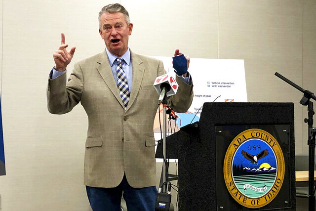 Idaho Gov. Brad Little speaks at a news conference Thursday, July 23, 2020 at Central District Health in Boise, Idaho. He said there are too many coronavirus cases and the state will remain in the fourth and final stage of his reopening plan for at least another two weeks. (AP Photo/Keith Ridler)