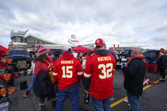 Fans tailgate outside Arrowhead Stadium before an NFL divisional round football game between the Kansas City Chiefs and the Cleveland Browns, Sunday, Jan. 17, 2021, in Kansas City. (AP Photo/Orlin Wagner)