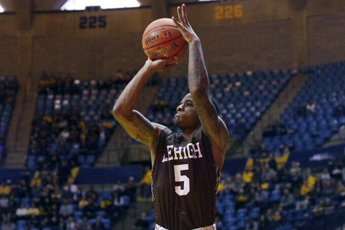 Lehigh guard Lance Tejada (5) shoots during the first half of an NCAA college basketball game against West Virginia, Sunday, Dec. 30, 2018, in Morgantown, W.Va. (AP Photo/Raymond Thompson)