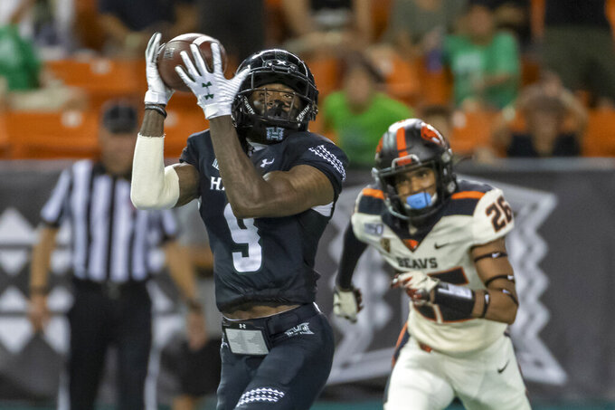 Hawaii wide receiver JoJo Ward (9) catches a pass for a touchdown while being defended by Oregon State defensive back Jojo Forest (26) during the second half of an NCAA college football game, Saturday, Sept. 7, 2019, in Honolulu. (AP Photo/Eugene Tanner)