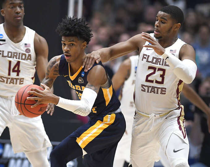 Florida State's M.J. Walker, right, fouls Murray State's Ja Morant, left, during the first half of a second round men's college basketball game in the NCAA tournament, Saturday, March 23, 2019, in Hartford, Conn. (AP Photo/Jessica Hill)