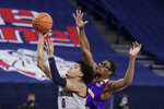 Gonzaga guard Julian Strawther, left, shoots in front of Northwestern State forward Jamaure Gregg during the second half of an NCAA college basketball game in Spokane, Wash., Tuesday, Dec. 22, 2020. Gonzaga won 95-78. (AP Photo/Young Kwak)