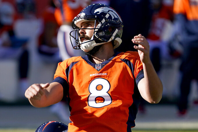 Denver Broncos kicker Brandon McManus (8) watches his field goal split the uprights during the first half of an NFL football game against the Los Angeles Chargers, Sunday, Nov. 1, 2020, in Denver. (AP Photo/David Zalubowski)