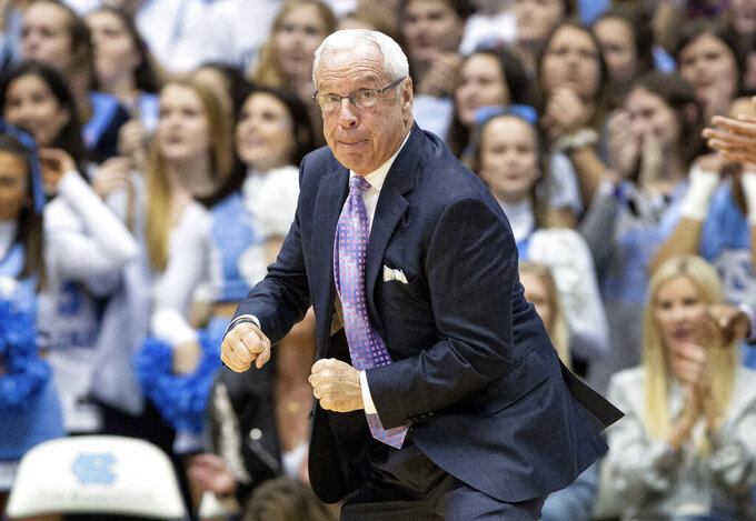 North Carolina head coach Roy Williams reacts to a call during the first half of an NCAA college basketball game against Elon in Chapel Hill, N.C., Wednesday, Nov. 20, 2019. (AP Photo/Ben McKeown)