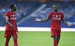 Liverpool's Naby Keita, left, and Liverpool's Sadio Mane discuss as they leave the pitch at half time during the English Premier League soccer match between Everton and Liverpool at Goodison Park in Liverpool, England, Sunday, June 21, 2020. (Peter Powell/Pool via AP)