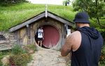 FILE - In this Dec. 31, 2015, file photo, tourists take photos during a tour of the Hobbit movie set near Matamata, New Zealand. Amazon announced Wednesday, Sept. 18, 2019, it will film its upcoming television series