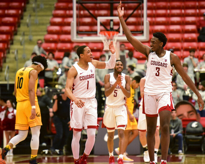 Washington State guard Jervae Robinson (1) and forward Robert Franks (3) celebrate after California coach Wyking Jones called a timeout during the second half of an NCAA college basketball game Thursday, Jan. 17, 2019, in Pullman, Wash. Washington State won 82-59. (Pete Caster/The Lewiston Tribune via AP)