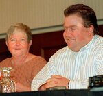 In this Oct. 28, 1996 photo, Richard Jewell, cleared of suspicion in the Olympic Park bombing, and his mother Barbara, face the media as Jewell's attorney Lin Wood addressed the press conference in Marietta, Ga. When a bomb exploded in a downtown Atlanta park midway through the 1996 Olympics, it set news reporters and law enforcement on a collision course that upended the life of a security guard, turning him from hero to villain overnight. Now, more than 20 years later, a recent book and upcoming movie explore Jewell's ordeal and the roles played by law enforcement and the media. (AP Photo/Ric Feld, File)