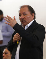 Nicaragua's President Daniel Ortega speaks at the opening of a national dialogue, in Managua, Nicaragua, Wednesday, May 16, 2018. Ortega sat down Wednesday to formally talk with opposition and civic groups for the first time since he returned to power in 2007. The dialogue comes after more than 60 people died amid a government crackdown on demonstrations against social security cuts. (AP Photo/Alfredo Zuniga)