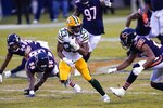 Green Bay Packers' Aaron Jones runs during the first half of an NFL football game against the Chicago Bears Sunday, Jan. 3, 2021, in Chicago. (AP Photo/Charles Rex Arbogast)