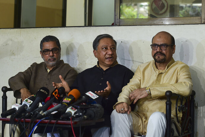 President of Bangladesh Cricket Board Nazmul Hassan Papon, center, speaks during a press conference on the status of the country's cricket team after Friday's mass shootings in New Zealand, in Dhaka, Bangladesh, Friday, March 15, 2019. Dozens of people were killed in mass shootings at two mosques full of worshippers attending Friday prayers on what the prime minister called