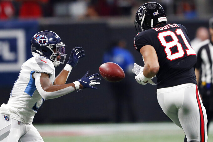 Atlanta Falcons tight end Austin Hooper (81) misses a catch against Tennessee Titans free safety Kevin Byard (31) during the first half of an NFL football game, Sunday, Sept. 29, 2019, in Atlanta. (AP Photo/John Bazemore)