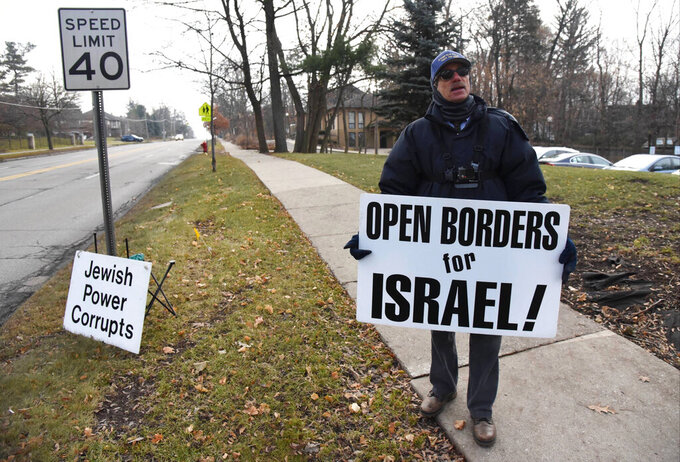 Henry Herskovitz leads a protest with anti-Israel and anti-Jewish messages outside the Beth Israel Congregation in Ann Arbor, Mich., on Dec. 28, 2019. A federal appeals court said Wednesday, Sept. 15, 2021, that protests at the site were protected by the First Amendment. (Ryan Stanton/Ann Arbor News via AP)
