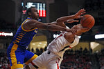 Cal State Bakersfield's Ronne Readus (0) fouls Texas Tech's Terrence Shannon Jr. (1) who tries to shoot during the first half of an NCAA college basketball game Sunday, Dec. 29, 2019, in Lubbock, Texas. (AP Photo/Brad Tollefson)