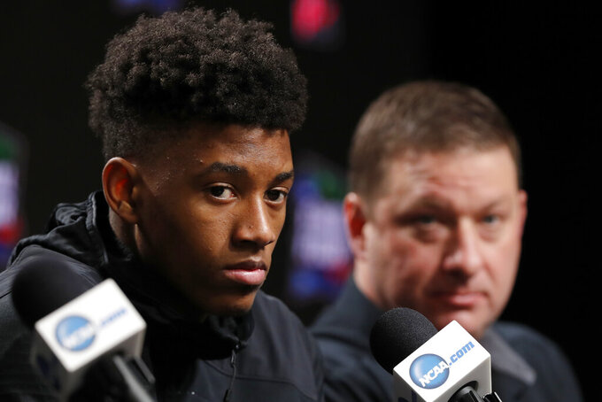 Texas Tech's Jarrett Culver, left, and head coach Chris Beard questions during a news conference for the championship of the Final Four NCAA college basketball tournament, Sunday, April 7, 2019, in Minneapolis. Texas Tech will play Virginia on Monday for the national championship. (AP Photo/Charlie Neibergall)
