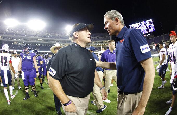 TCU head coach Gary Patterson and Duquesne head coach Jerry Schmitt talk following an NCAA college football game Saturday, Sept. 4, 2021, in Fort Worth, Texas. TCU won 45-3. (AP Photo/Ron Jenkins)