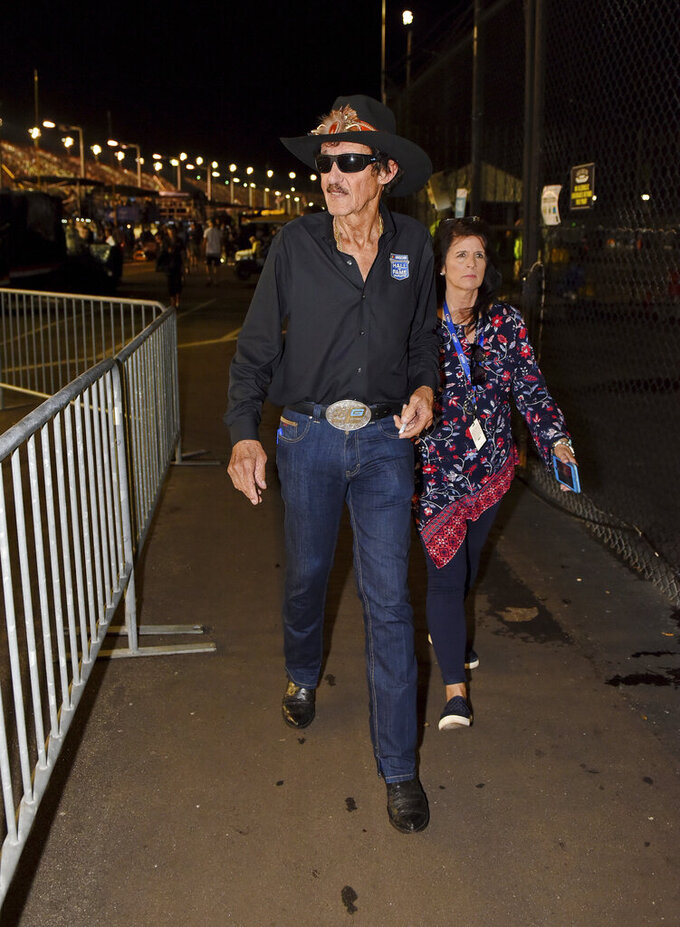 Racing legend Richard Petty walks down pit row during a NASCAR Cup Series auto race on Sunday, Sept. 1, 2019, at Darlington Raceway in Darlington, S.C. (AP Photo/Richard Shiro)
