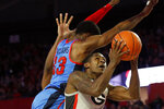 Mississippi guard Bryce Williams (13) blocks a shot from Georgia's Jordan Harris (2) during an NCAA college basketball game in Athens, Ga., Saturday, Jan. 25, 2020. (Joshua L. Jones/Athens Banner-Herald via AP)