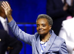 Mayor of Chicago Lori Lightfoot waves after being sworn in during her inauguration ceremony Monday, May 20, 2019, in Chicago. (AP Photo/Jim Young)