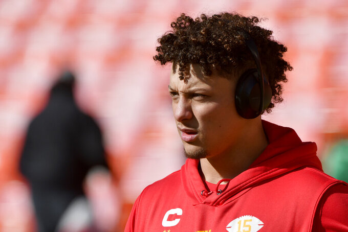 Kansas City Chiefs' Patrick Mahomes warms up before the NFL AFC Championship football game against the Tennessee Titans Sunday, Jan. 19, 2020, in Kansas City, MO. (AP Photo/Ed Zurga)