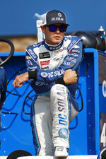 FILE - In this Aug. 10, 2018, file photo, Kyle Larson watches before qualifications for a NASCAR Cup Series auto race at Michigan International Speedway in Brooklyn, Mich. Kyle Larson was fired Tuesday, April 14, 2020, by Chip Ganassi Racing, a day after nearly every one of his sponsors dropped the star driver for using a racial slur during a live stream of a virtual race. Larson, in his seventh Cup season with Ganassi and considered the top free agent in NASCAR mere weeks ago, is now stunningly out of a job in what could ultimately be an eight-figure blunder by the star.  (AP Photo/Paul Sancya, File)