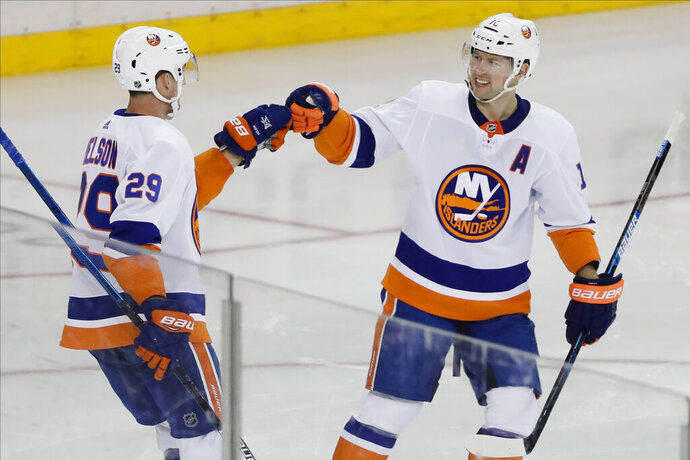 New York Islanders' Josh Bailey (12) celebrates with Brock Nelson (29) after Nelson scored a goal during the third period of an NHL hockey game against the New York Rangers Tuesday, Jan. 21, 2020, in New York. The Islanders won 4-2. (AP Photo/Frank Franklin II)