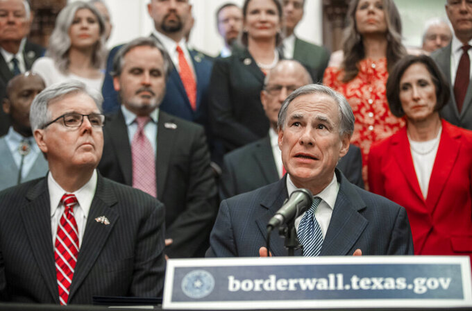 """Gov. Greg Abbott speaks during a press conference on details of his plan for Texas to build a border wall and provide $250 million in state funds as a """"down payment."""", Wednesday, June 16, 2021 in Austin, Texas. (Ricardo B. Brazziell/Austin American-Statesman via AP)"""