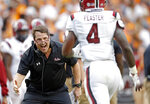 South Carolina head coach Will Muschamp congratulates running back Tavien Feaster (4) after scoring a touchdown in the first half of an NCAA college football game against Tennessee, Saturday, Oct. 26, 2019, in Knoxville, Tenn. (AP Photo/Wade Payne)