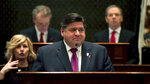 FILE - In this Wednesday, Feb. 20, 2019, file pool photo, Illinois Gov. J.B. Pritzker delivers his first budget address on to a joint session of the Illinois House and Senate at the Illinois State Capitol building in Springfield, Ill. Legislatures in roughly two dozen states are considering bills to legalize sports gambling, made possible after a Supreme Court ruling last year ended Nevada's monopoly. Lawmakers have introduced more than 100 legalization bills around the country. Many of them have broad support, but they also reveal areas of dispute, such as whether to allow betting on college games and what to do with any new state revenue. (E. Jason Wambsgans/Chicago Tribune via AP, Pool, File)