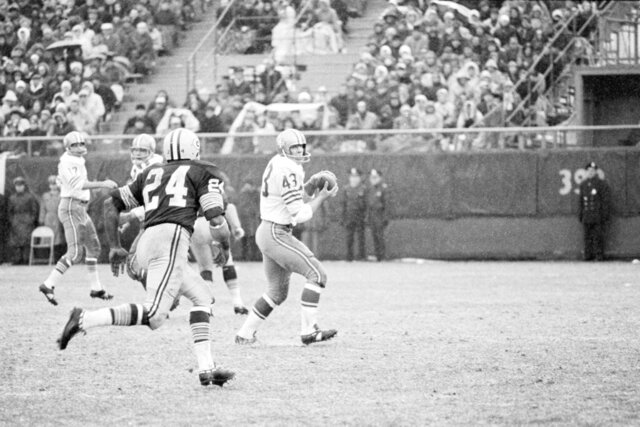 FILE - In this Dec. 4, 1966, file photo, San Francisco 49ers Dave Kopay, right, receives a pass and skampers for about 18 yards before Breen Bay Packers' Willie Woods catches him and brings him down in the third quarter in Green Bay, WI. Kopay is a 78-year-old former National Football League running back living in Palm Springs, California and known as the first professional athlete to reveal he was gay. He came out in 1975 after his NFL career ended. (AP Photo, File)