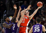 Illinois forward Giorgi Bezhanishvili (15) shoots against Northwestern center Dererk Pardon, left, and guard Ryan Greer during the first half of an NCAA college basketball game in the first round of the Big Ten Conference tournament in Chicago, Wednesday, March 13, 2019. (AP Photo/Nam Y. Huh)