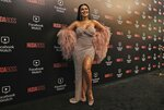 Huda Kattan poses at the Huda Boss Facebook Watch screening celebration in Dubai, United Arab Emirates, Wednesday, Oct. 9, 2019. (AP Photo/Kamran Jebreili)