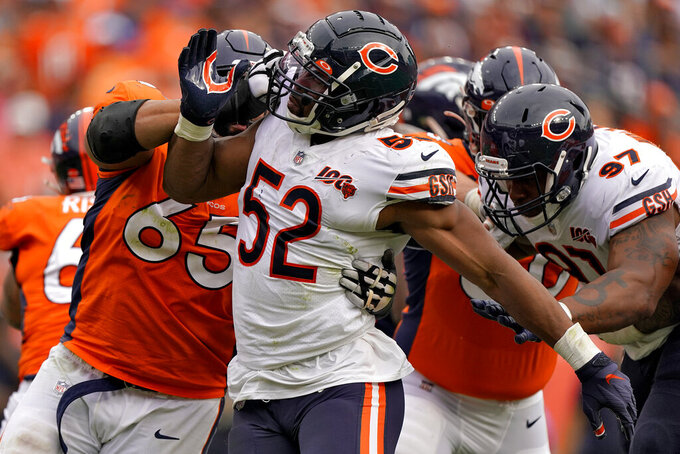 Chicago Bears outside linebacker Khalil Mack (52) battles against Denver Broncos offensive guard Ronald Leary (65) during the second half of an NFL football game, Sunday, Sept. 15, 2019, in Denver. (AP Photo/Jack Dempsey)