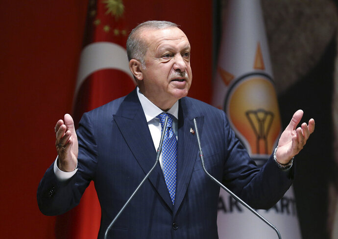 Turkey's President Recep Tayyip Erdogan addresses his ruling party members, in Ankara, Turkey, Friday, July 26, 2019. Erdogan says Turkey is determined to destroy what he called a