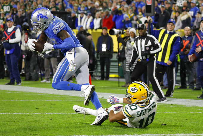Detroit Lions cornerback Justin Coleman (27) intercepts a pass intended for Green Bay Packers wide receiver Darrius Shepherd (10) during the second half of an NFL football game Monday, Oct. 14, 2019, in Green Bay, Wis. (AP Photo/Jeffrey Phelps)