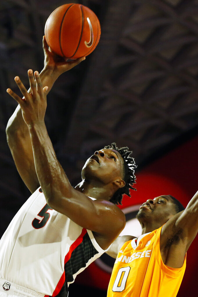 Georgia's Anthony Edwards (5) shoots next to Tennessee guard Davonte Gaines (0) during the first half of an NCAA college basketball game Wednesday, Jan. 15, 2020, in Athens, Ga. (Joshua L. Jones/Athens Banner-Herald via AP)