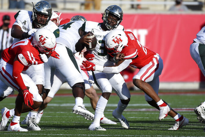 South Florida quarterback Jordan McCloud (3) is sacked by Houston linebacker Jordan Moore during the first half of an NCAA college football game, Saturday, Nov. 14, 2020, in Houston. (AP Photo/Eric Christian Smith)