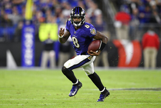 FILE - Baltimore Ravens quarterback Lamar Jackson (8) scrambles during the second half of an NFL divisional playoff football game against the Tennessee Titans, Saturday, Jan. 11, 2020, in Baltimore. Jackson hopes to lead the Ravens to the postseason. (AP Photo/Nick Wass, File)