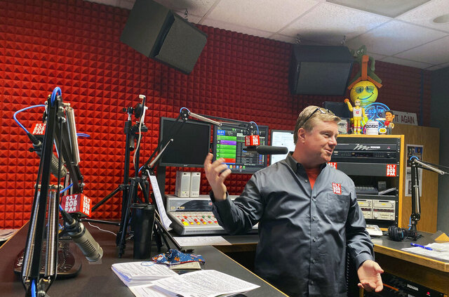 This Friday, May 22, 2020 photo shows Eric Worden in his studio in Norfolk, Va. Worden started inviting students as guest broadcasters on his morning show to give them something special to do while schools are closed for the coronavirus pandemic. The segment has become more popular than he imagined. (Sara Gregory/The Virginian-Pilot via AP)