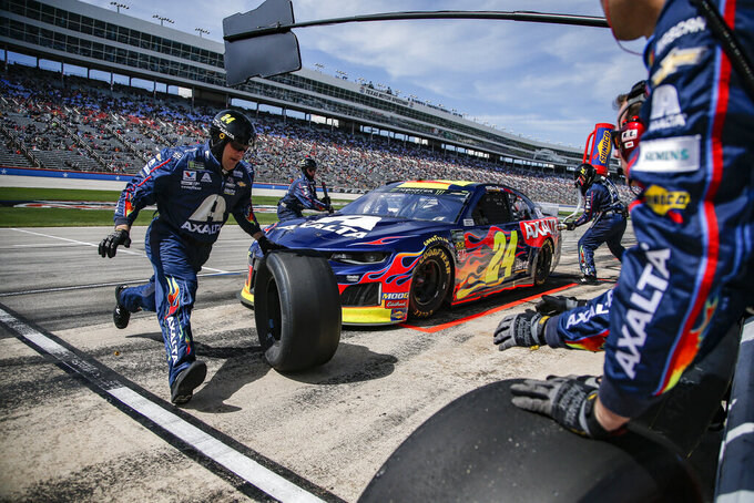 Driver William Byron's pit crew service his car during a NASCAR Cup auto race at Texas Motor Speedway, Sunday, March 31, 2019, in Fort Worth, Texas. (AP Photo/Brandon Wade)
