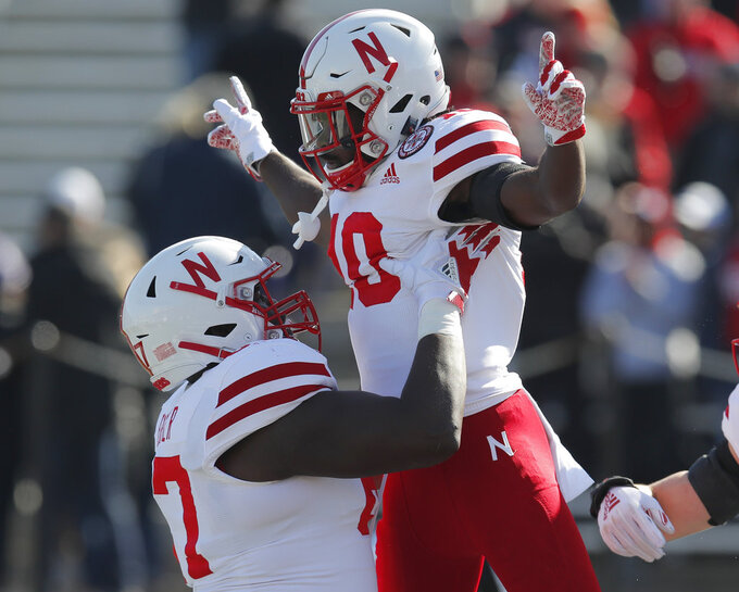 Nebraska's JD Spielman, right, celebrates with teammate Jerald Foster after scoring a touchdown against Northwestern during the first half of an NCAA college football game Saturday, Oct. 13, 2018, in Evanston, Ill.. (AP Photo/Jim Young)