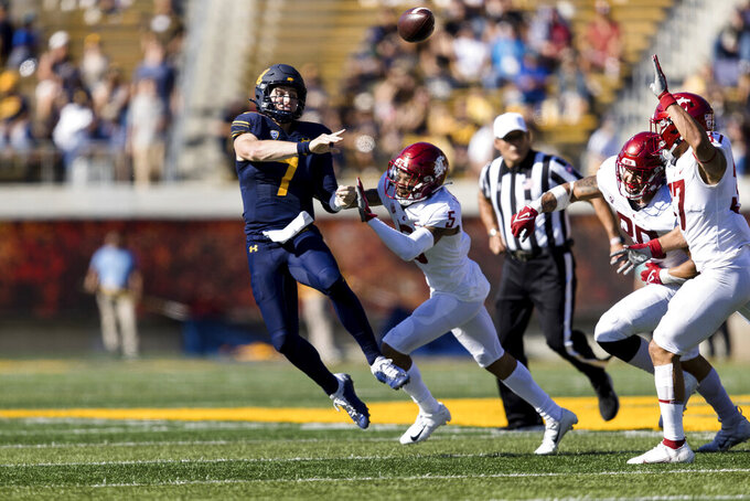 California quarterback Chase Garbers (7) throws a pass under pressure from Washington State defensive back Derrick Langford (5) in the second quarter of an NCAA college football game in Berkeley, Calif., Saturday, Oct. 2, 2021. (AP Photo/John Hefti)
