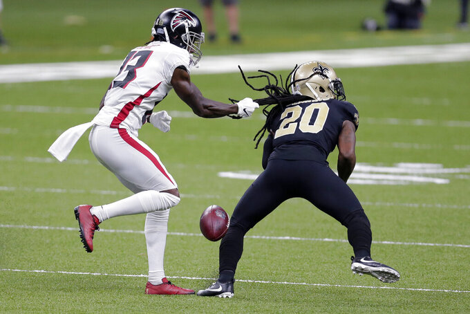 Atlanta Falcons wide receiver Christian Blake (13) pulls the hair of New Orleans Saints cornerback Janoris Jenkins (20) as he drops the ball on a near interception in the first half of an NFL football game in New Orleans, Sunday, Nov. 22, 2020. (AP Photo/Brett Duke)