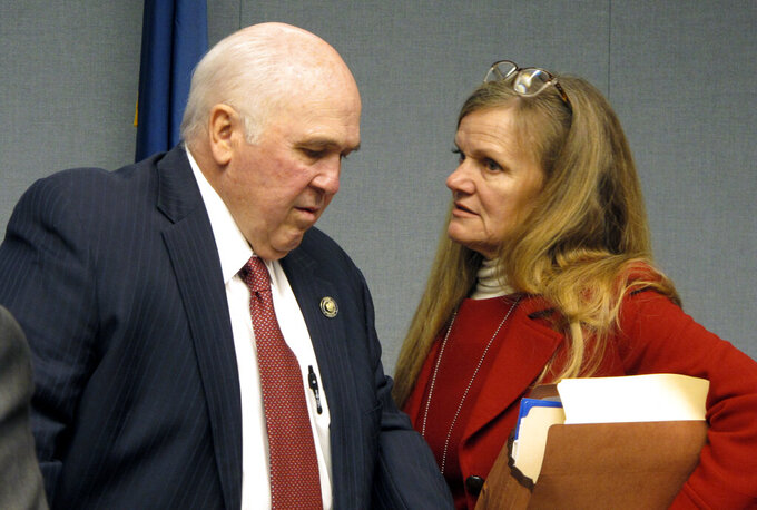 """FILE- In this Feb. 7, 2020 file photo, state Sen. Mack """"Bodi"""" White, R-Central, chairman of the Joint Legislative Committee on the Budget, speaks with Senate financial adviser Sherry Phillips-Hymel ahead of the governor's budget presentation in Baton Rouge, La. With huge sums to spend and no cuts to haggle over, senators voted 38-0 for the operating budget with little discussion and no questions after it was presented by Finance Chairman Bodi White, the Baton Rouge-area Republican who handles the budget bills in the Senate.  (AP Photo/Melinda Deslatte, File)"""