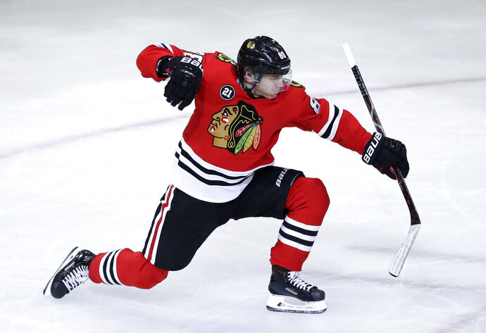 Chicago Blackhawks right wing Patrick Kane celebrates after scoring a goal against the Detroit Red Wings during the third period of an NHL hockey game Sunday, Feb. 10, 2019, in Chicago. (AP Photo/Nam Y. Huh)