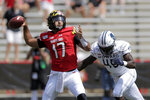 Maryland quarterback Josh Jackson (17) looks to pass as Howard defensive lineman Elton Jean-Baptiste (45) moves in to make a hit on him during the first half of an NCAA college football game, Saturday, Aug. 31, 2019, in College Park, Md. (AP Photo/Julio Cortez)