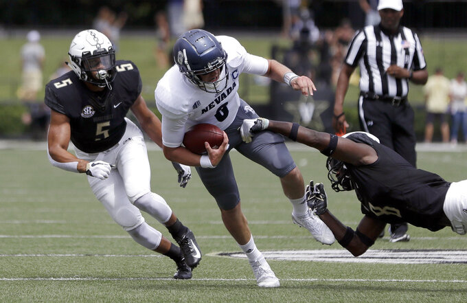 Nevada quarterback Ty Gangi (6) is brought down by Vanderbilt cornerback Joejuan Williams (8) in the first half of an NCAA college football game Saturday, Sept. 8, 2018, in Nashville, Tenn. (AP Photo/Mark Humphrey)